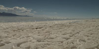 Pickaxes break silence of Bolivia's expansive salt flats